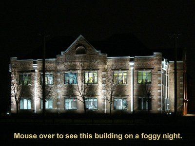 Professional building with exterior illuminated by metal halide up-lighting.