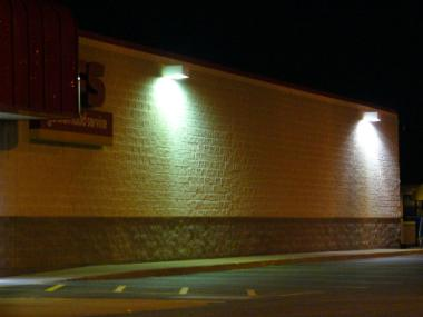 Shielded wall-mounted lights direct their light output where it is needed.